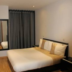 Отель VivaCity Porto Улучшенный номер разные типы кроватей фото 15