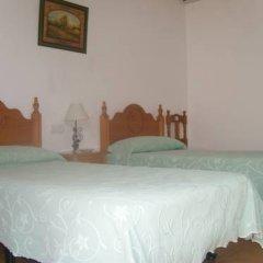 Отель Hostal El Canario Стандартный номер с двуспальной кроватью