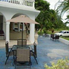 Отель By The Sea Vacation Home And Villa 3* Люкс с различными типами кроватей фото 36