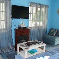 Отель By The Sea Vacation Home And Villa 3* Люкс с различными типами кроватей фото 3