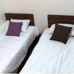 Отель Suncity Guest House 2* Стандартный номер с 2 отдельными кроватями фото 2