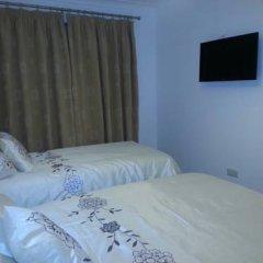 Отель Apple House Guesthouse Wembley 4* Стандартный семейный номер с различными типами кроватей (общая ванная комната) фото 2