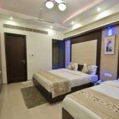 Hotel Om International Стандартный семейный номер с двуспальной кроватью