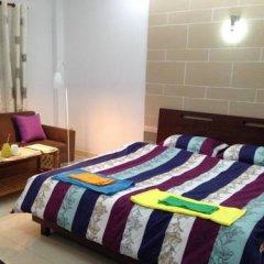 Отель Goconnect Homestay Улучшенный номер с различными типами кроватей
