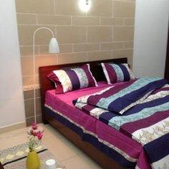 Отель Goconnect Homestay Улучшенный номер с различными типами кроватей фото 3