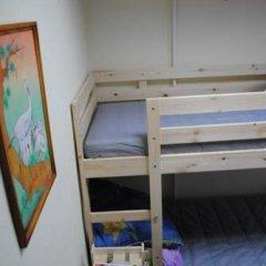 Хостел Smiles Кровать в общем номере с двухъярусной кроватью фото 11