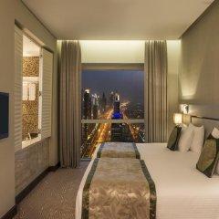 Millennium Plaza Hotel 5* Улучшенный номер с 2 отдельными кроватями фото 2