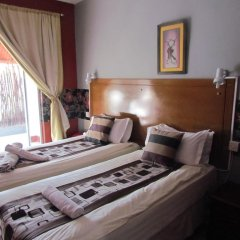 Отель Dolar Lodges & Tours комната для гостей фото 4