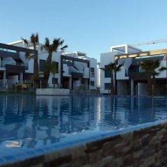 Отель Penthouse Oasis Beach La Zenia Испания, Ориуэла - отзывы, цены и фото номеров - забронировать отель Penthouse Oasis Beach La Zenia онлайн бассейн фото 3