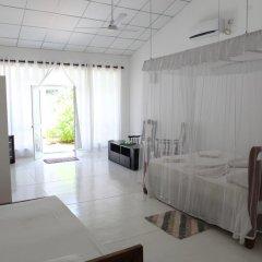 Отель Chitra Ayurveda Hotel Шри-Ланка, Бентота - отзывы, цены и фото номеров - забронировать отель Chitra Ayurveda Hotel онлайн комната для гостей фото 3