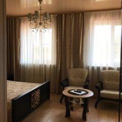 Гостиница Сафари Улучшенный семейный номер с разными типами кроватей фото 7