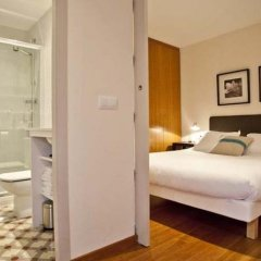 Отель Palauet Tres Torres Барселона сейф в номере
