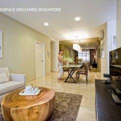 Отель Fraser Residence Orchard Улучшенные апартаменты с различными типами кроватей