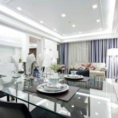 Отель Rocco Huahin Condominium Люкс с различными типами кроватей