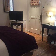 Отель Suites Unic Renoir Saint-Germain Франция, Париж - отзывы, цены и фото номеров - забронировать отель Suites Unic Renoir Saint-Germain онлайн удобства в номере