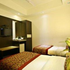 Отель The Prime Balaji Deluxe @ New Delhi Railway Station 3* Номер Делюкс с различными типами кроватей фото 9
