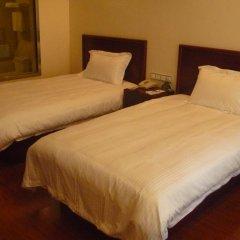 GreenTree Inn Jiangxi Jiujiang Shili Avenue Business Hotel 2* Стандартный номер с 2 отдельными кроватями фото 2
