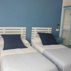 Отель Hostal Puerto Beach Стандартный номер с 2 отдельными кроватями