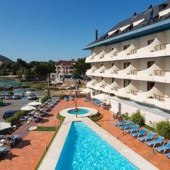 Отель Astuy Apartamentos Арнуэро бассейн фото 3