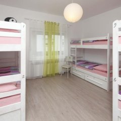 Pozitiv Hostel Кровать в общем номере с двухъярусной кроватью фото 2
