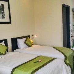 Отель Starfruit Homestay Hoi An 2* Стандартный семейный номер с двуспальной кроватью фото 10