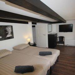 Отель Coco's Outback Apartments Нидерланды, Амстердам - отзывы, цены и фото номеров - забронировать отель Coco's Outback Apartments онлайн комната для гостей фото 4