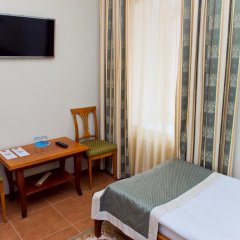 Гостиница Усадьба 4* Классический семейный номер с различными типами кроватей фото 10