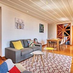 Апартаменты Localtraveling ALFAMA River View - Family Apartments комната для гостей фото 3