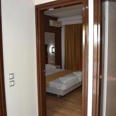 Апартаменты Maria Apartments Парадиси комната для гостей фото 2