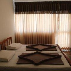Отель Queens rest inn Номер Делюкс с двуспальной кроватью фото 10