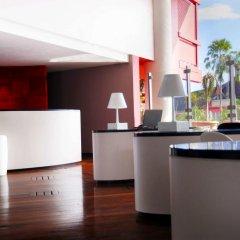 Отель Tahiti Ia Ora Beach Resort - Managed by Sofitel Французская Полинезия, Пунаауиа - отзывы, цены и фото номеров - забронировать отель Tahiti Ia Ora Beach Resort - Managed by Sofitel онлайн интерьер отеля фото 2