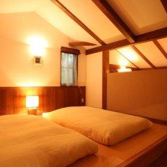 Отель Auberge - A Ma Façon - Минамиогуни комната для гостей
