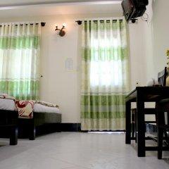 Отель Hoang Nga Guest House 2* Стандартный номер с различными типами кроватей фото 2