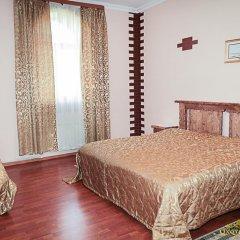 Гостиница Охотничья Усадьба Стандартный семейный номер с разными типами кроватей фото 14