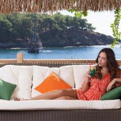 Justiniano Deluxe Resort Турция, Окурджалар - отзывы, цены и фото номеров - забронировать отель Justiniano Deluxe Resort онлайн балкон