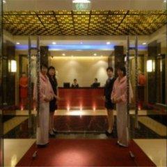 Отель Zhongshan Tegao Business Hotel Китай, Чжуншань - отзывы, цены и фото номеров - забронировать отель Zhongshan Tegao Business Hotel онлайн интерьер отеля фото 2
