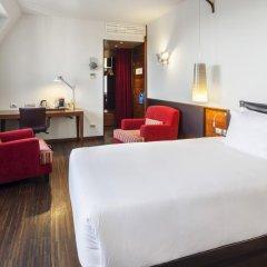 Отель NH Milano Touring 4* Стандартный номер двуспальная кровать фото 3