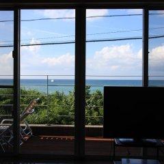 Отель Cottage Seaside Центр Окинавы комната для гостей фото 3