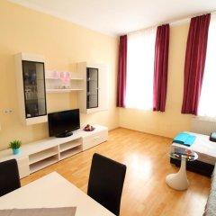 Апартаменты Klimt Apartments Вена комната для гостей фото 5