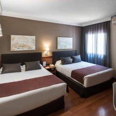 Отель Catalonia Castellnou 3* Стандартный семейный номер с двуспальной кроватью фото 2