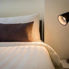 Отель The Grass Serviced Suites by At Mind Люкс с 2 отдельными кроватями