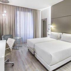 Отель NH Milano Touring 4* Улучшенный номер разные типы кроватей фото 19