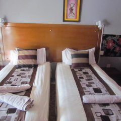 Отель Dolar Lodges & Tours Стандартный номер с 2 отдельными кроватями фото 5