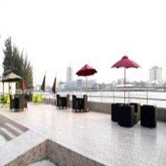 Отель Tivoli Garden Ikoyi Waterfront Нигерия, Лагос - отзывы, цены и фото номеров - забронировать отель Tivoli Garden Ikoyi Waterfront онлайн пляж фото 2