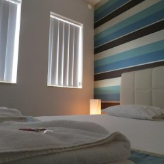 Отель 115 The Strand Suites комната для гостей фото 4
