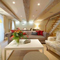 Отель Garden Luxury Residence Латвия, Рига - отзывы, цены и фото номеров - забронировать отель Garden Luxury Residence онлайн комната для гостей