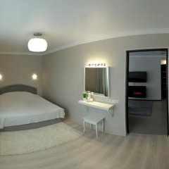 Апартаменты Lotos for You Apartments Николаев комната для гостей фото 2