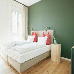 Апартаменты Design-Apartments im lebendigen Haus комната для гостей фото 3