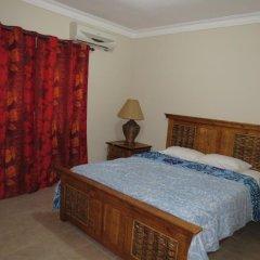 Отель Hostel Punta Cana Доминикана, Пунта Кана - отзывы, цены и фото номеров - забронировать отель Hostel Punta Cana онлайн комната для гостей фото 2