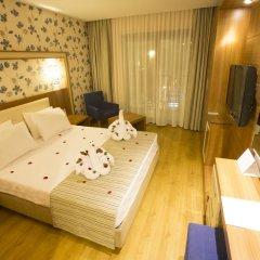 Отель Liberty Hotels Oludeniz 4* Улучшенный номер с двуспальной кроватью фото 7